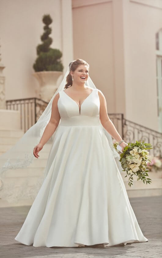 a051cdbad418ff Simply beautiful, this royal-inspired plus-size wedding dress is as  timeless as love itself. From.