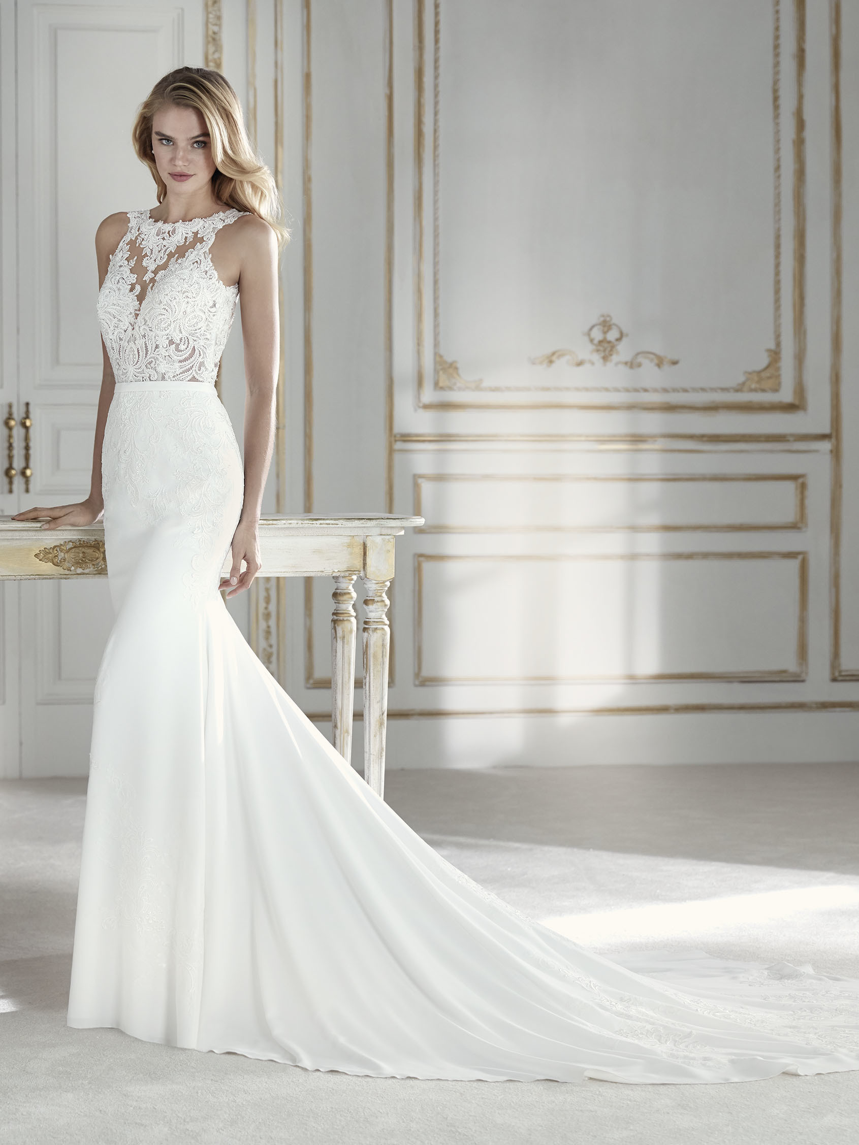 5beb007c1b57 Elegant mermaid wedding dress in which the crepe skirt meets tulle and lace  at the waist to form .